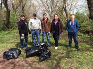 The volunteers who covered the Green Lane to the Lagoon section of Bristol Borough pose with the fruits of their labor.